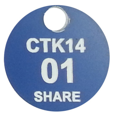 Blue traffolyte tag that has been laser engrave to let the white layer show though