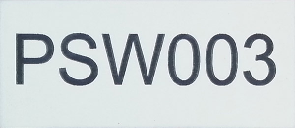 Small laser cut and engraved black and white traffolyte panel marked with serial and identification numbers.